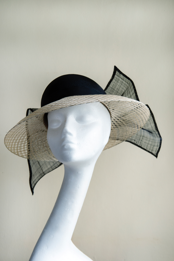 Classic picture hat with window pane brim   Based on the classic picture hat shape. This hat has a straw crown with a window pane sinamay brim, trimmed with a big sinamay bow.