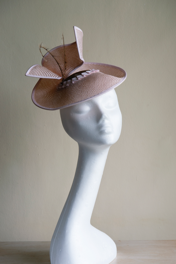 Pale pink and mink straw hat *Sold*   With pheasant feather coils. This hat is secured to the head with an elastic.