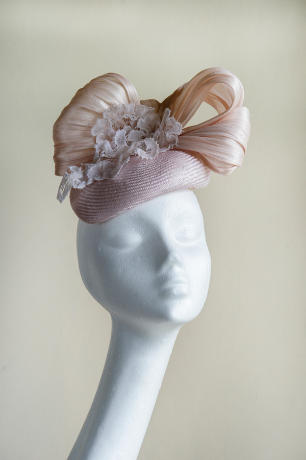 Pale pink straw button hat   trimmed with a silk abaca box, and wired vintage lace. This hat is secured to the head with an elastic.