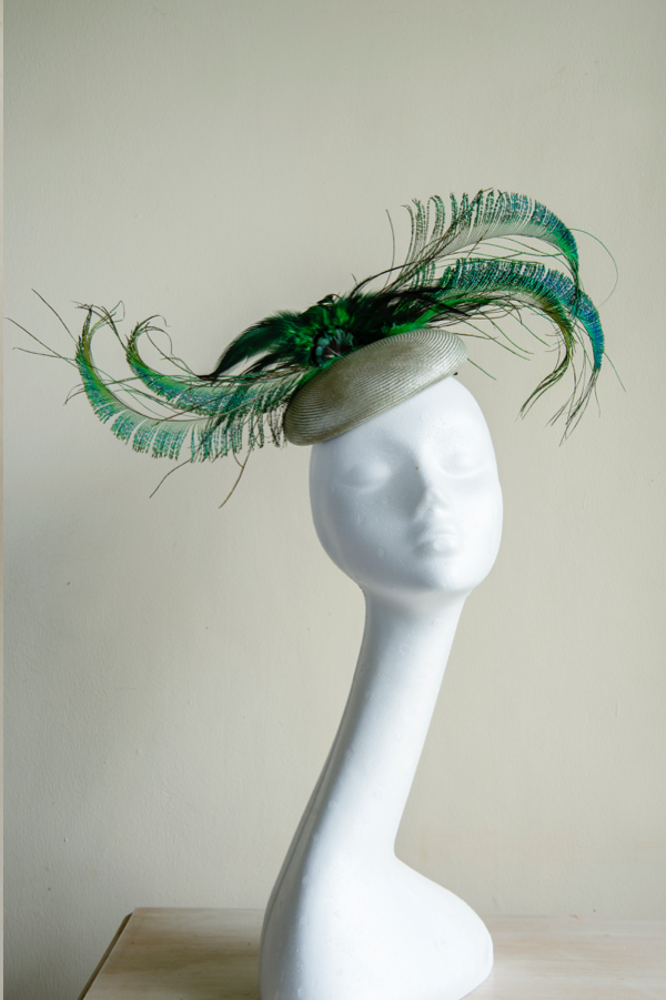 Vintage parabuntal straw button hat   Trimmed with peacock feather swords.