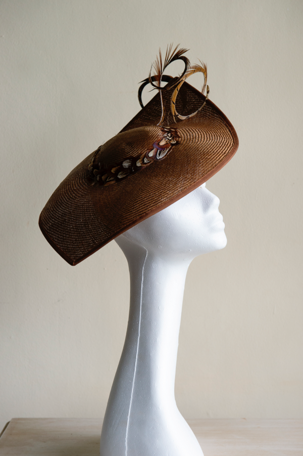 Vintage straw hat *Sold*   Trimmed with pheasant feather coils and feathers. This hat is secured to the head with an elastic.