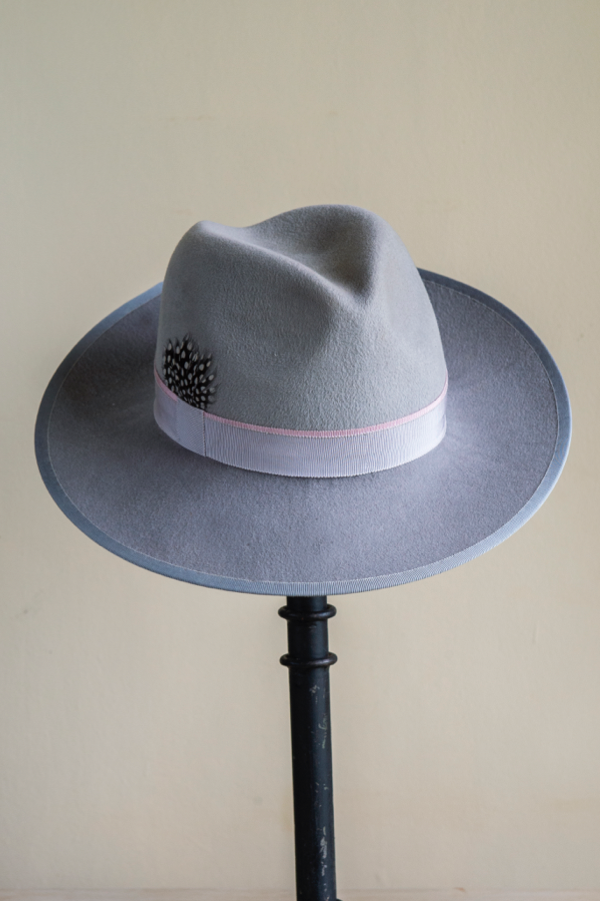Grey peachbloom felt trilby   hand blocked and trimmed with guinea fowl feathers. An easy to wear shape, perfect for safari and winter races.