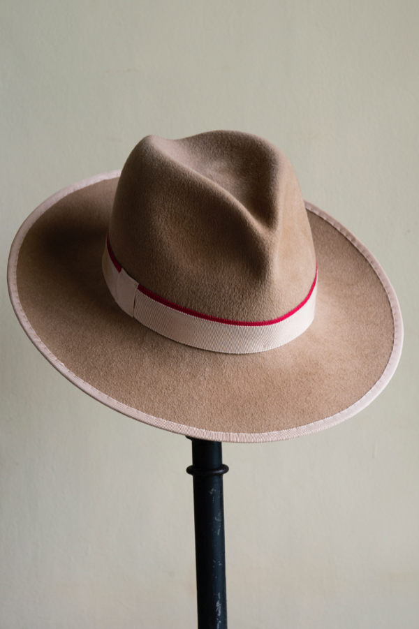 Beige peachbloom felt trilby   Hand-blocked and trimmed with Petersham ribbon.