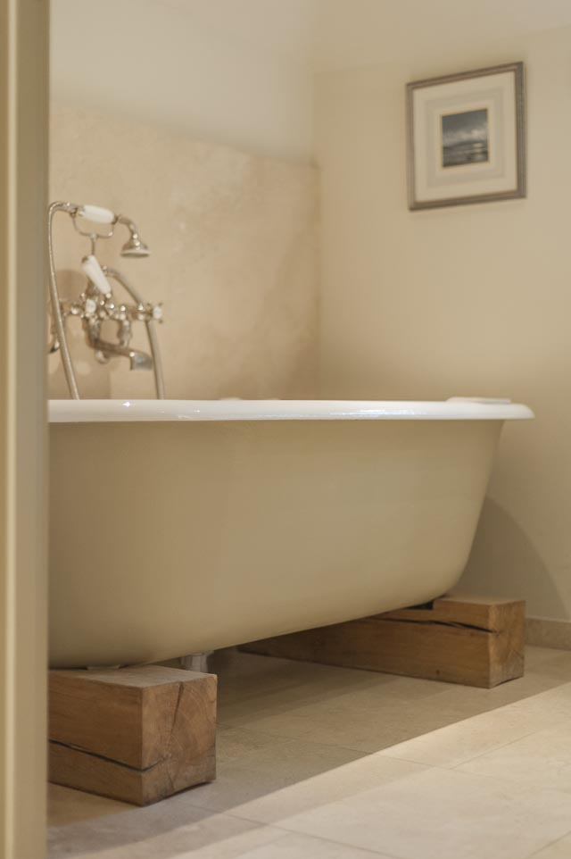 Roll Top Bath with Oak Plinths - www.jolliffdevelopments.com