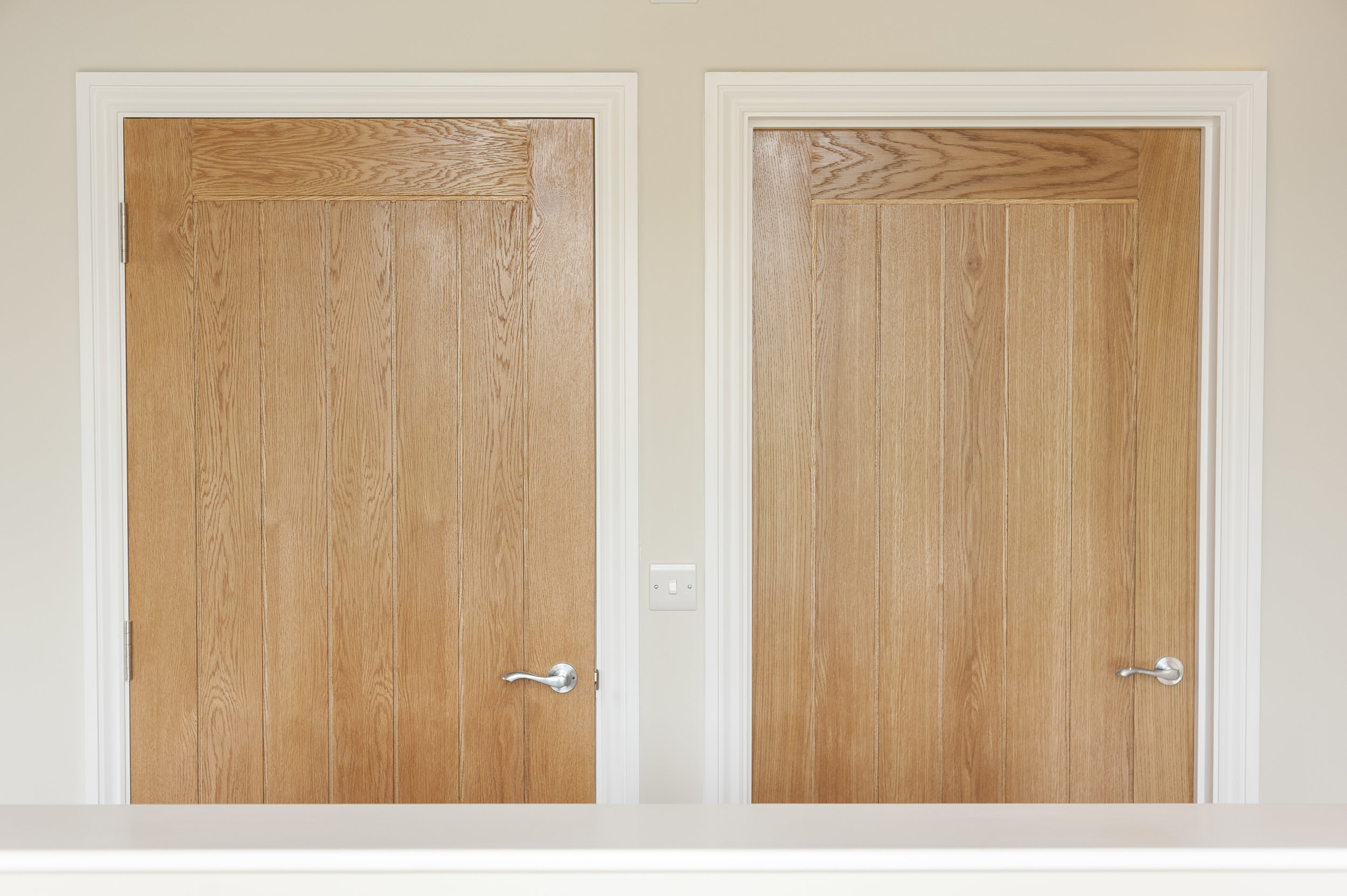 Oak Panelled Door with Brushed Chrome Hardware