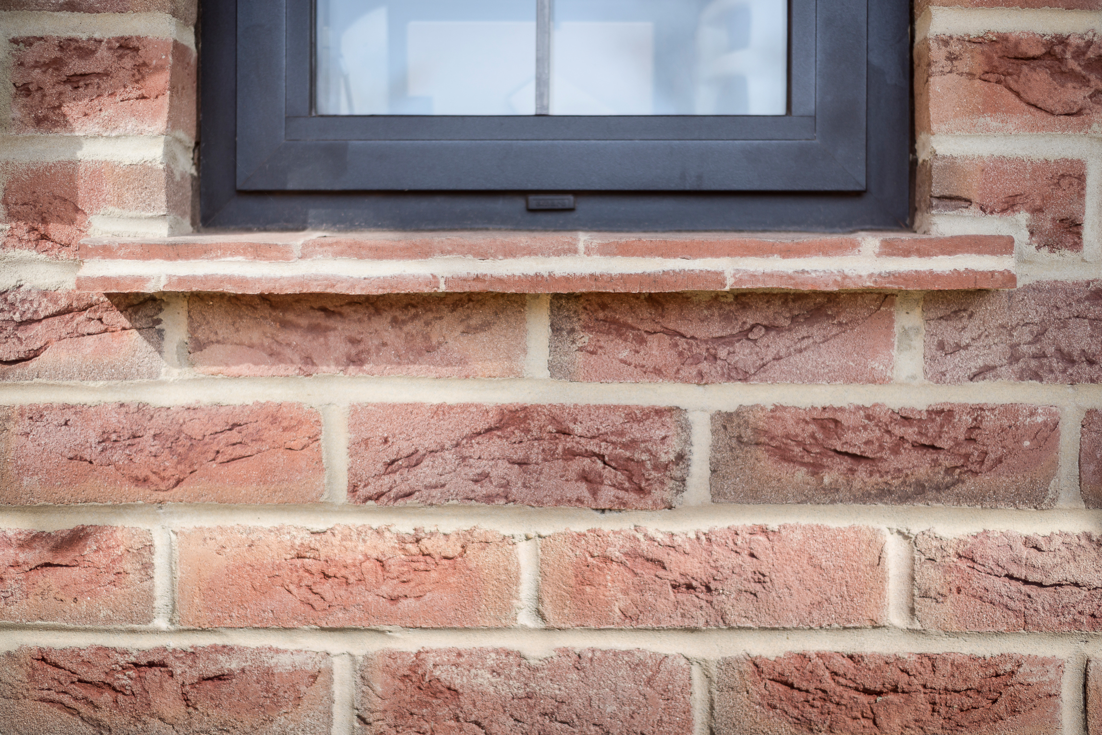 Leaded Light Window with Tiled Window Ledge and Brick Detail