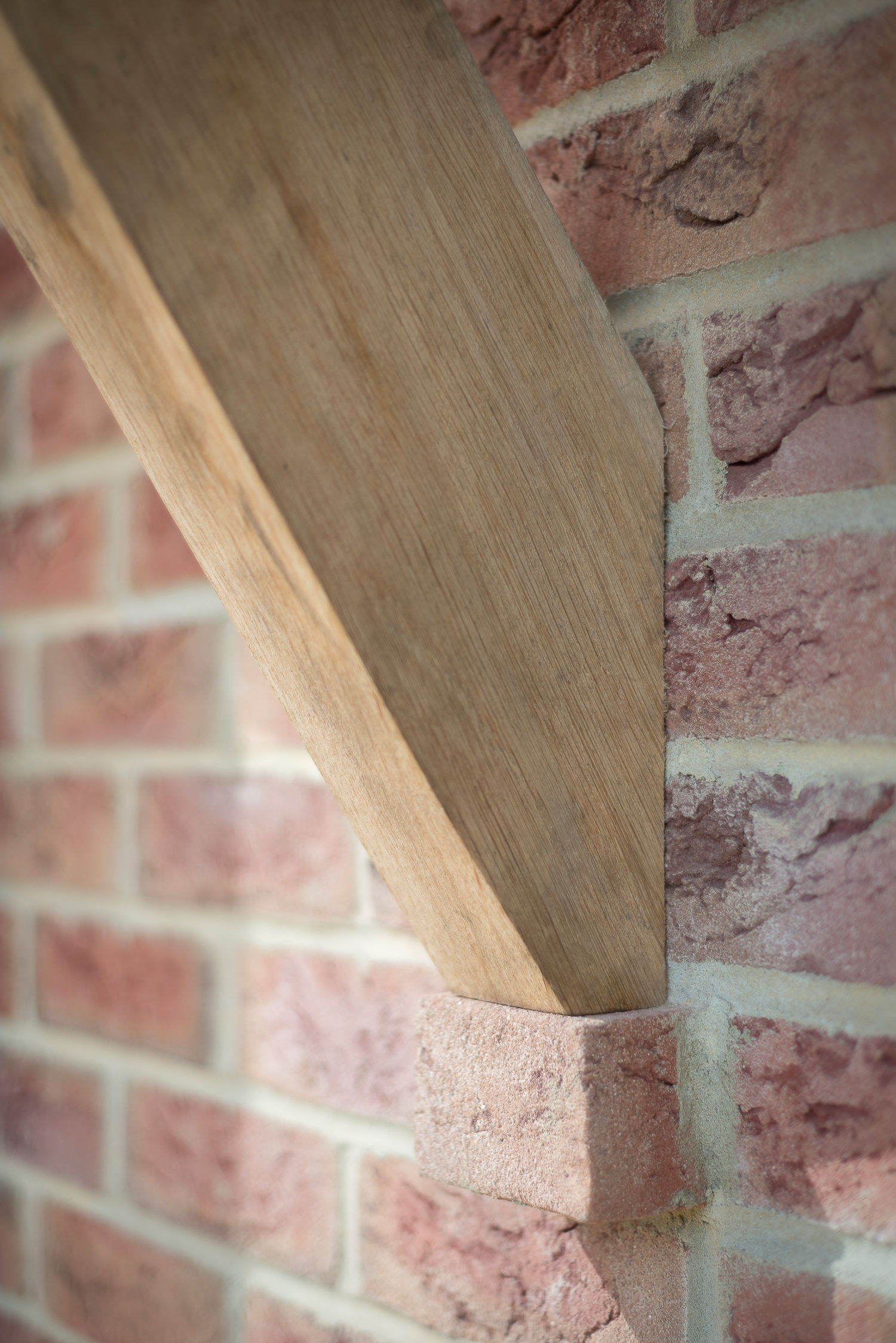 Green Oak Porch Supported by Stepped Brick Detail