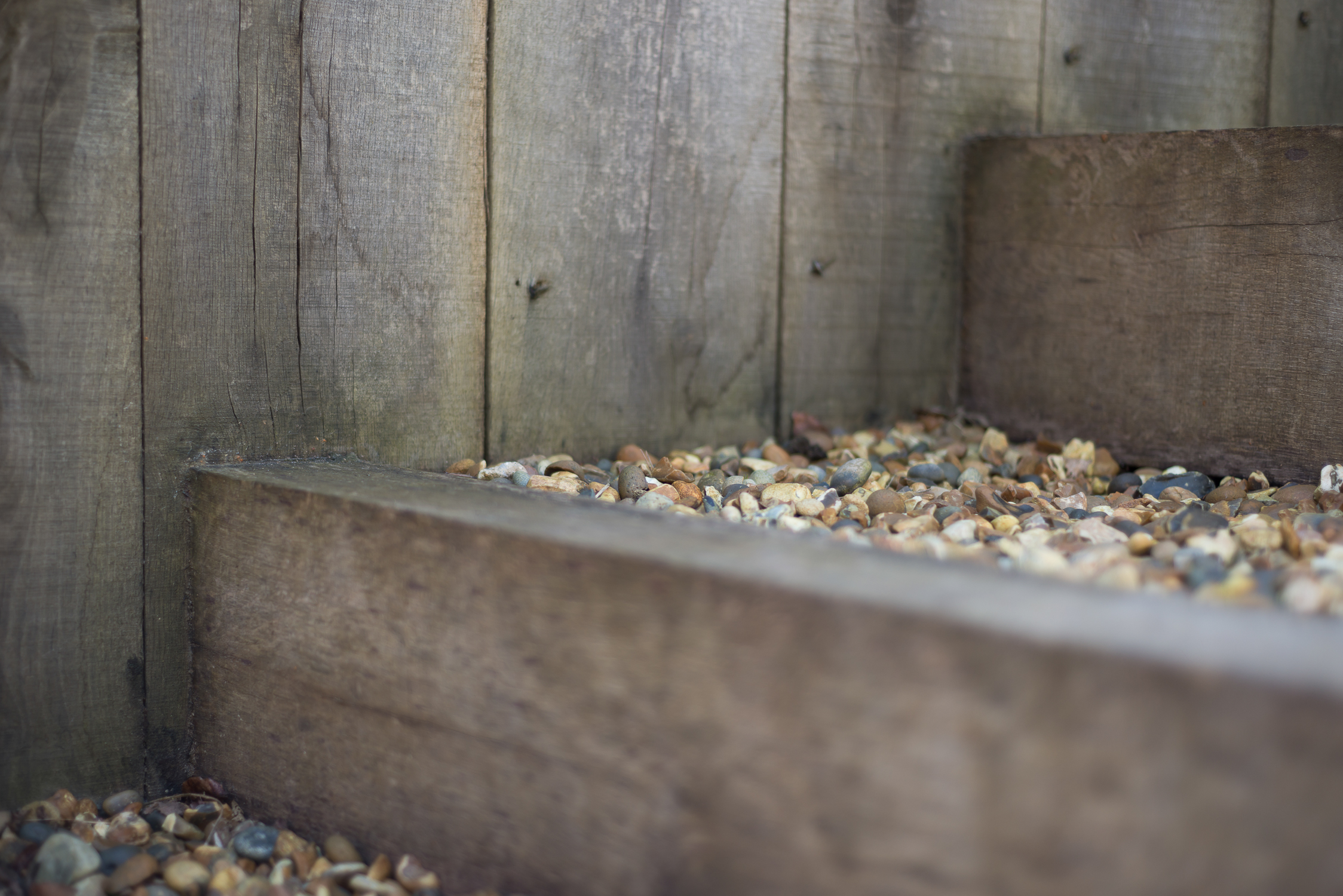 Detail of Weathered Oak Post Retaining Wall and Risers with Shingle Treads