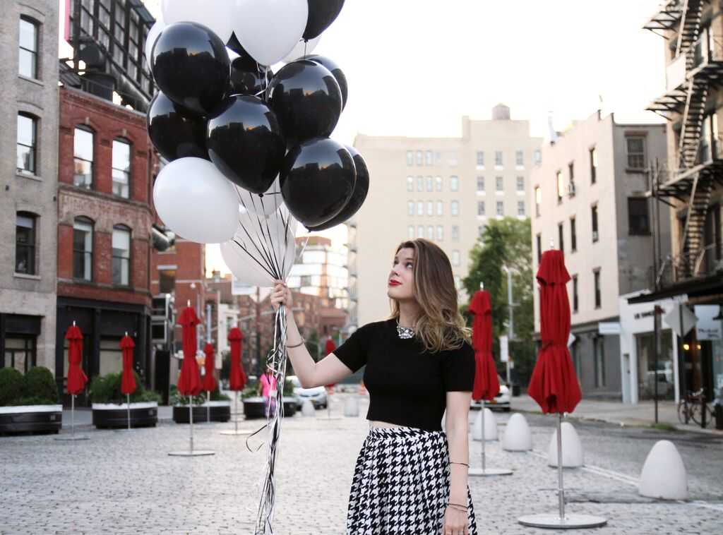 Do I let the balloons go? Do I not? /  Photo Cred: Clickamiphoto