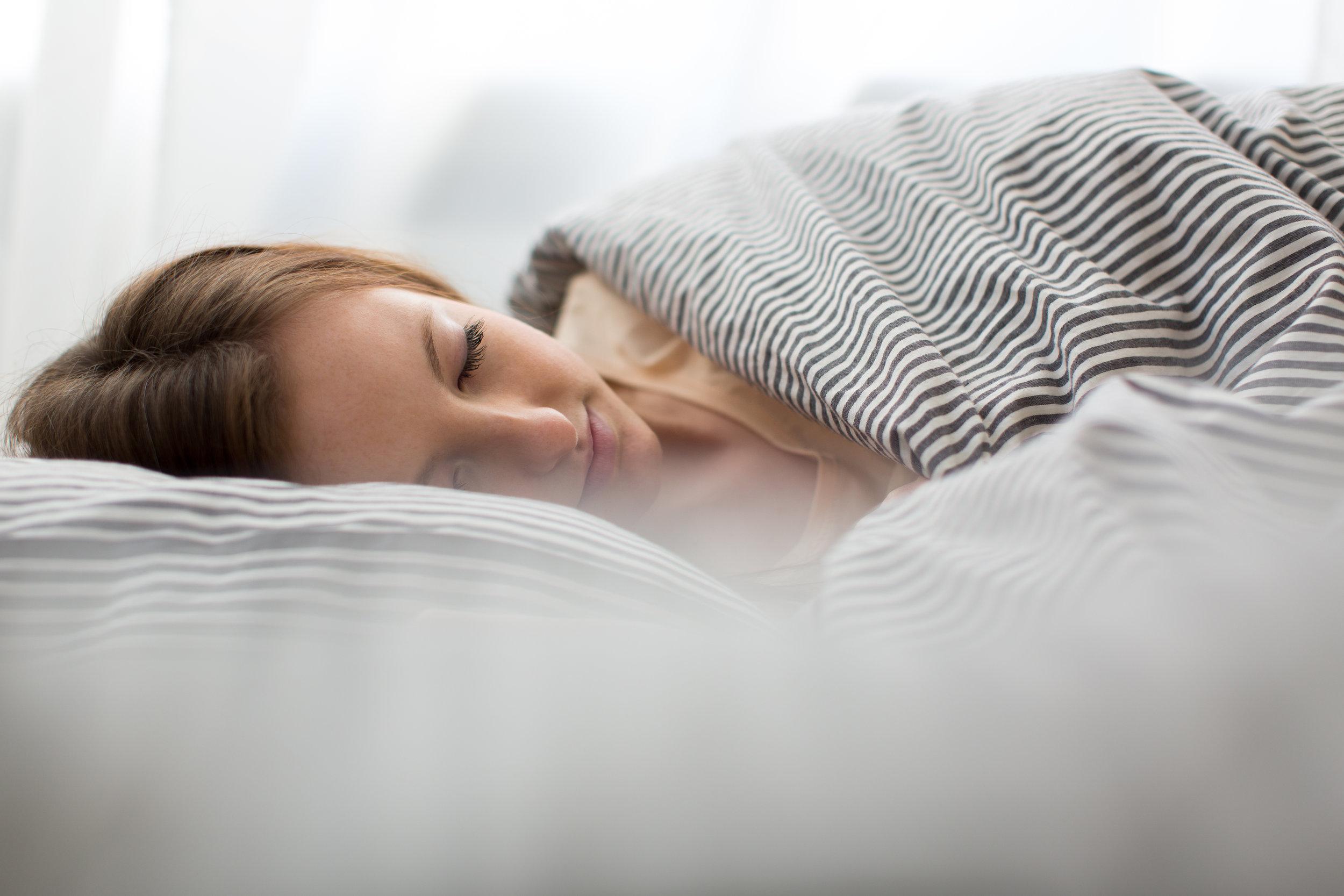 bigstock-Beautiful-young-woman-sleeping-95805215.jpg