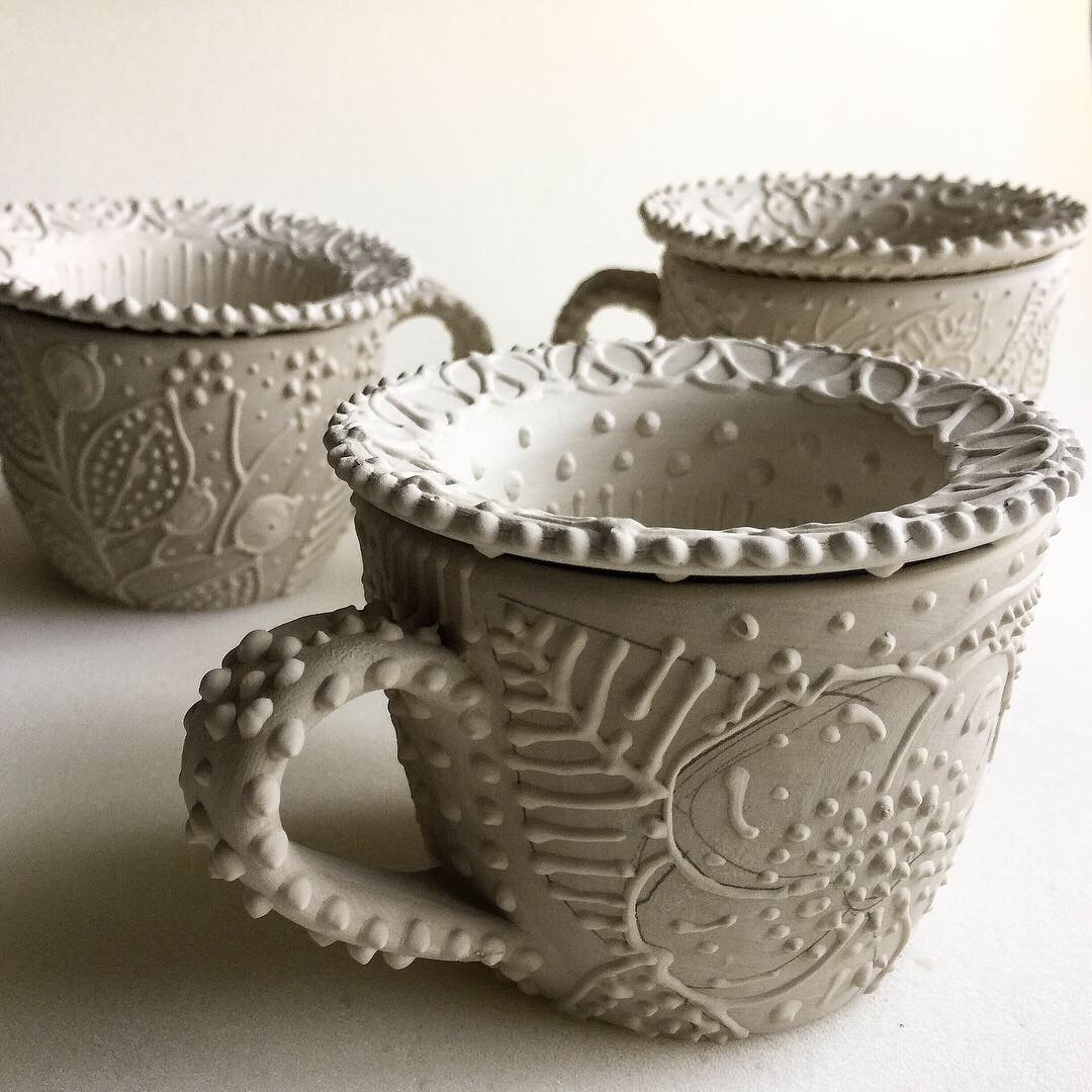 Teacups with loose leaf infusers in the works