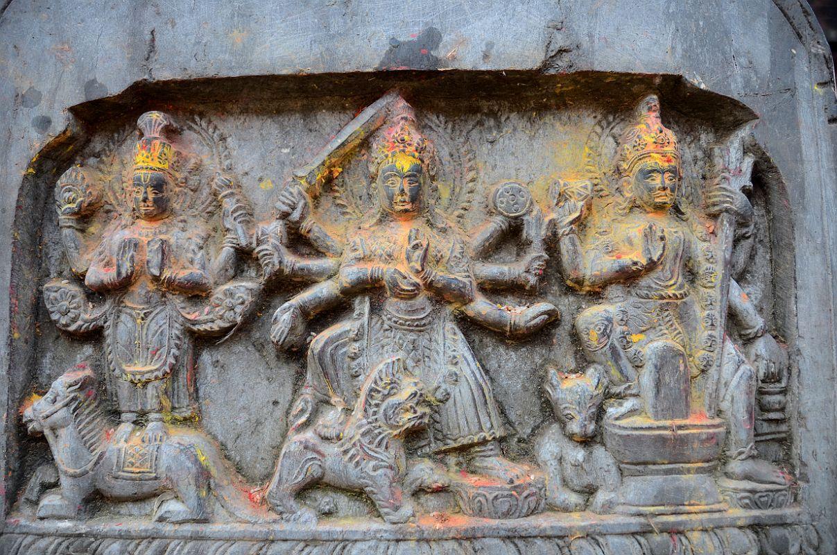 Kathmandu Changu Narayan 29 Vishnu, Durga, And Shiva Carvings On A Stone In Front Of The North Entrance To Changu Narayan Temple.jpg