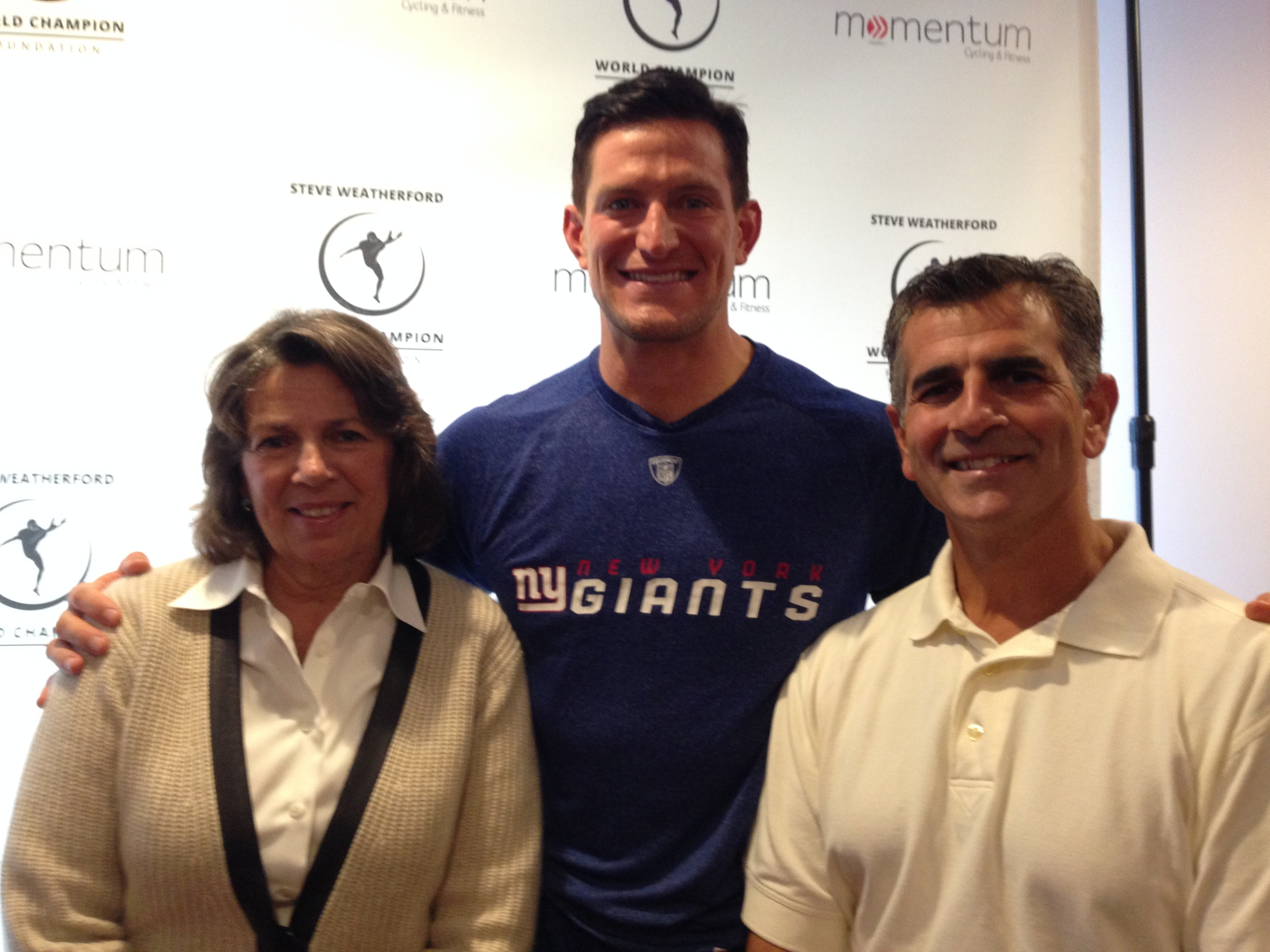 Dr. Rubino and Ellen Dickson at the ribbon cutting ceremony for Momentum Cycling & Fitness on Saturday, September 13th. NY Giants punter Steve Weatherford was there for the festivities.