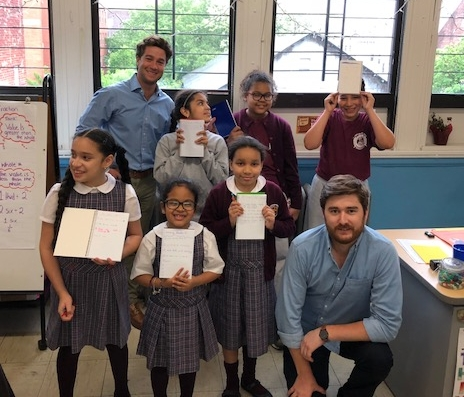 Advisors Matt and Patrick with the students and their Kindness Notebooks for their Summer Kindness Project.