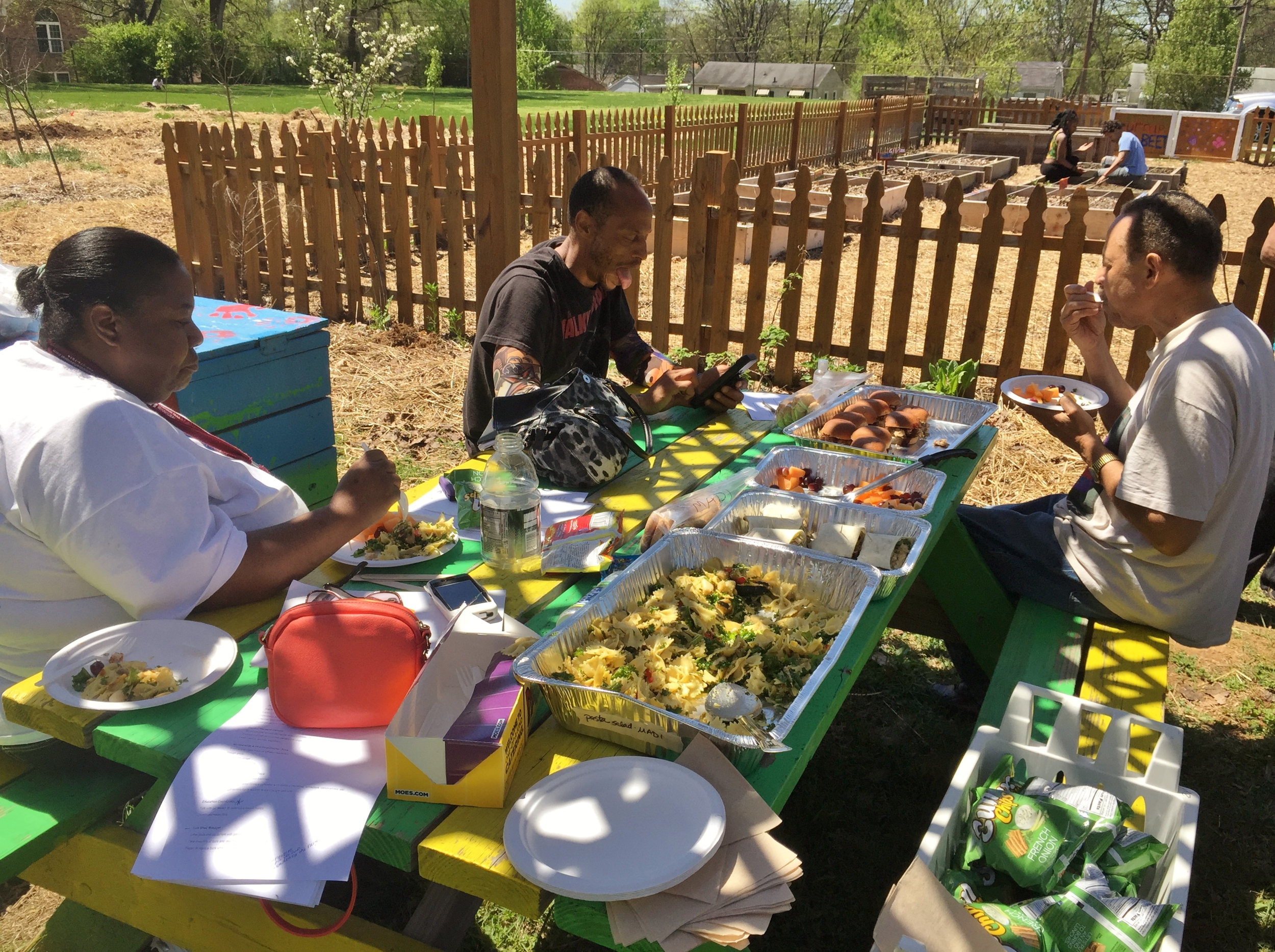 After planting spring crops and working together to get seed potatoes in the ground, the McGruder Green Thumbers gathered around picnic tables to relax and enjoy a delicious lunch.