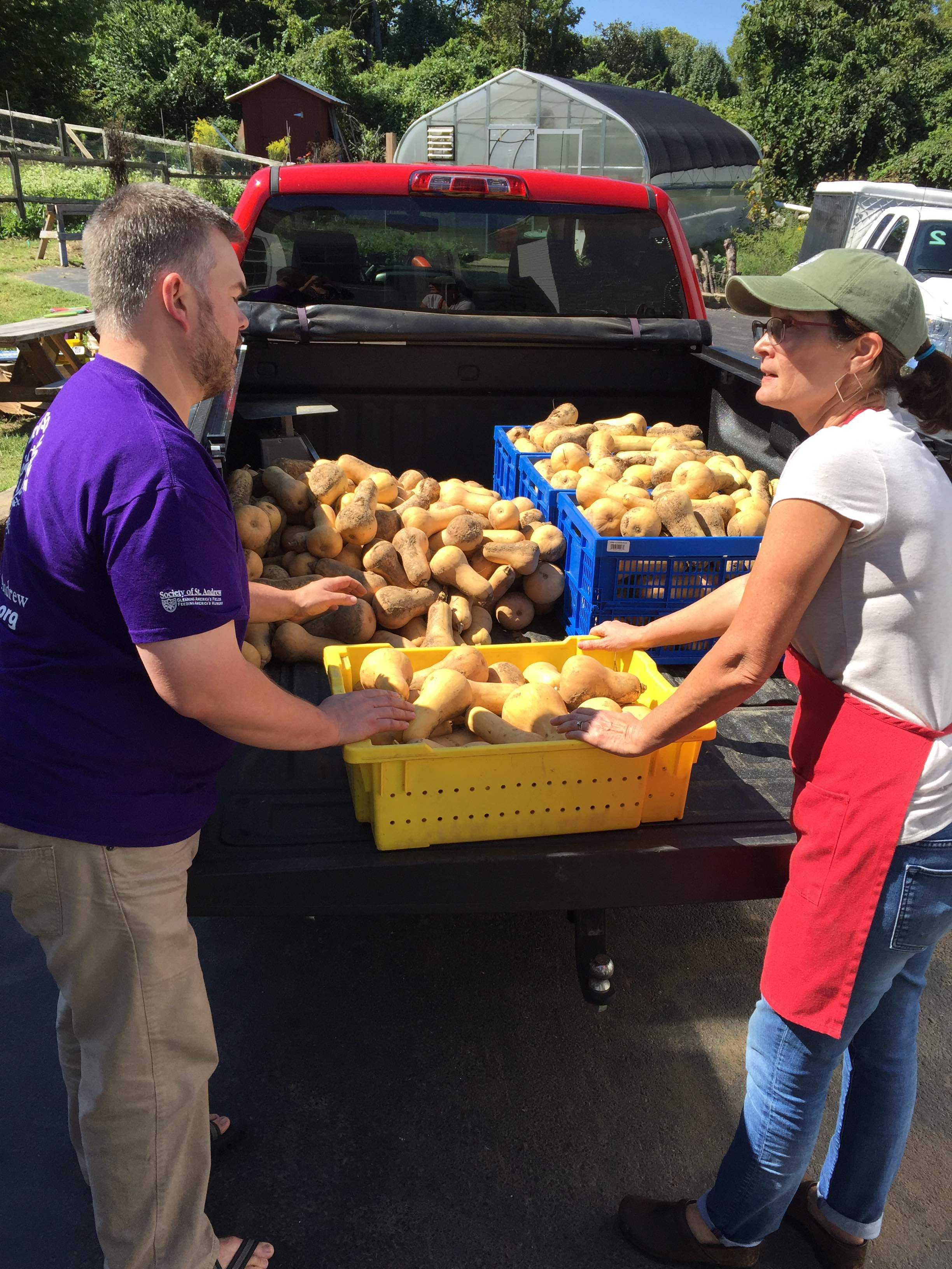 The Society of St. Andrew, a ministry that salvages food from local farms,makes a delivery of butternut squash to TNFP.