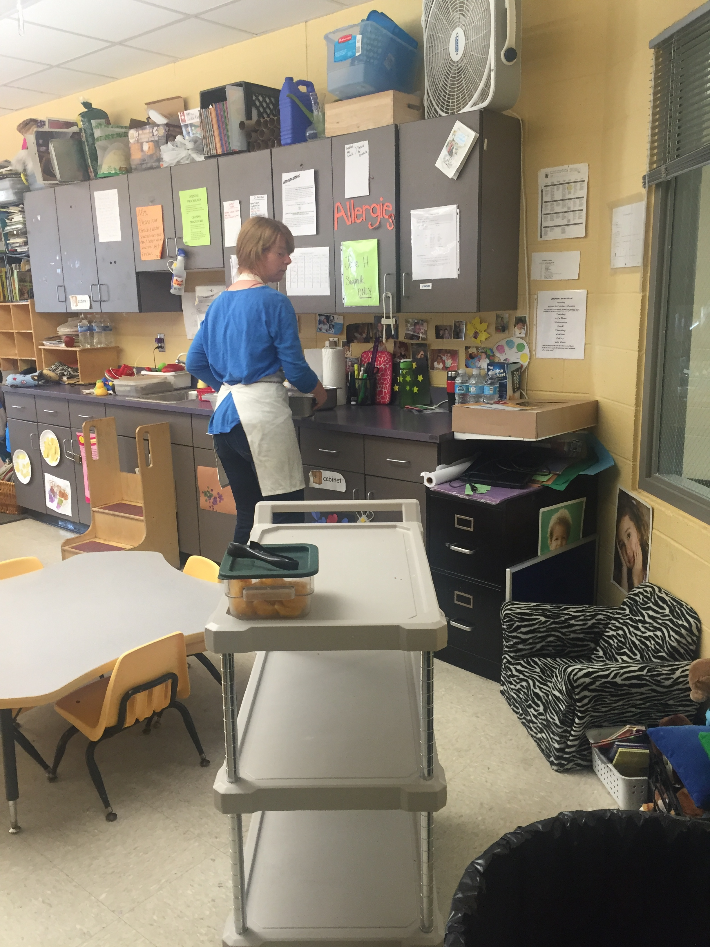 And here she is setting up lunch in one of the preschool classrooms. There, the teachers will portion the food out and serve the kids this yummy lunch.