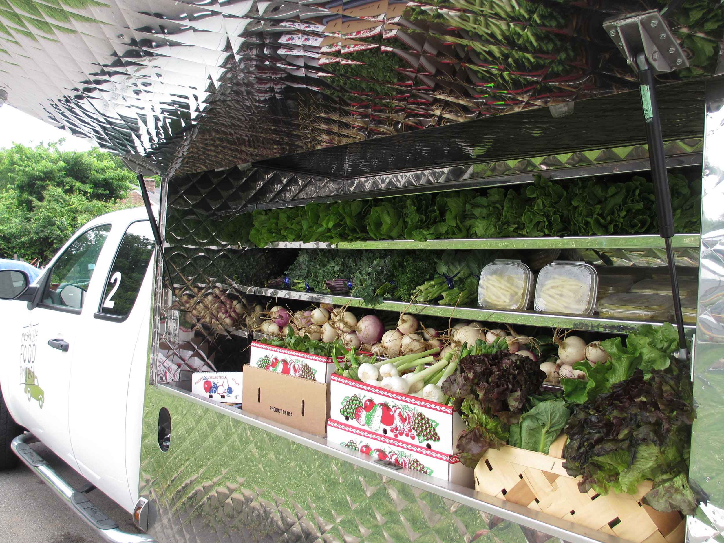 Passenger side: space for market-style display of fresh produce or sack lunch items