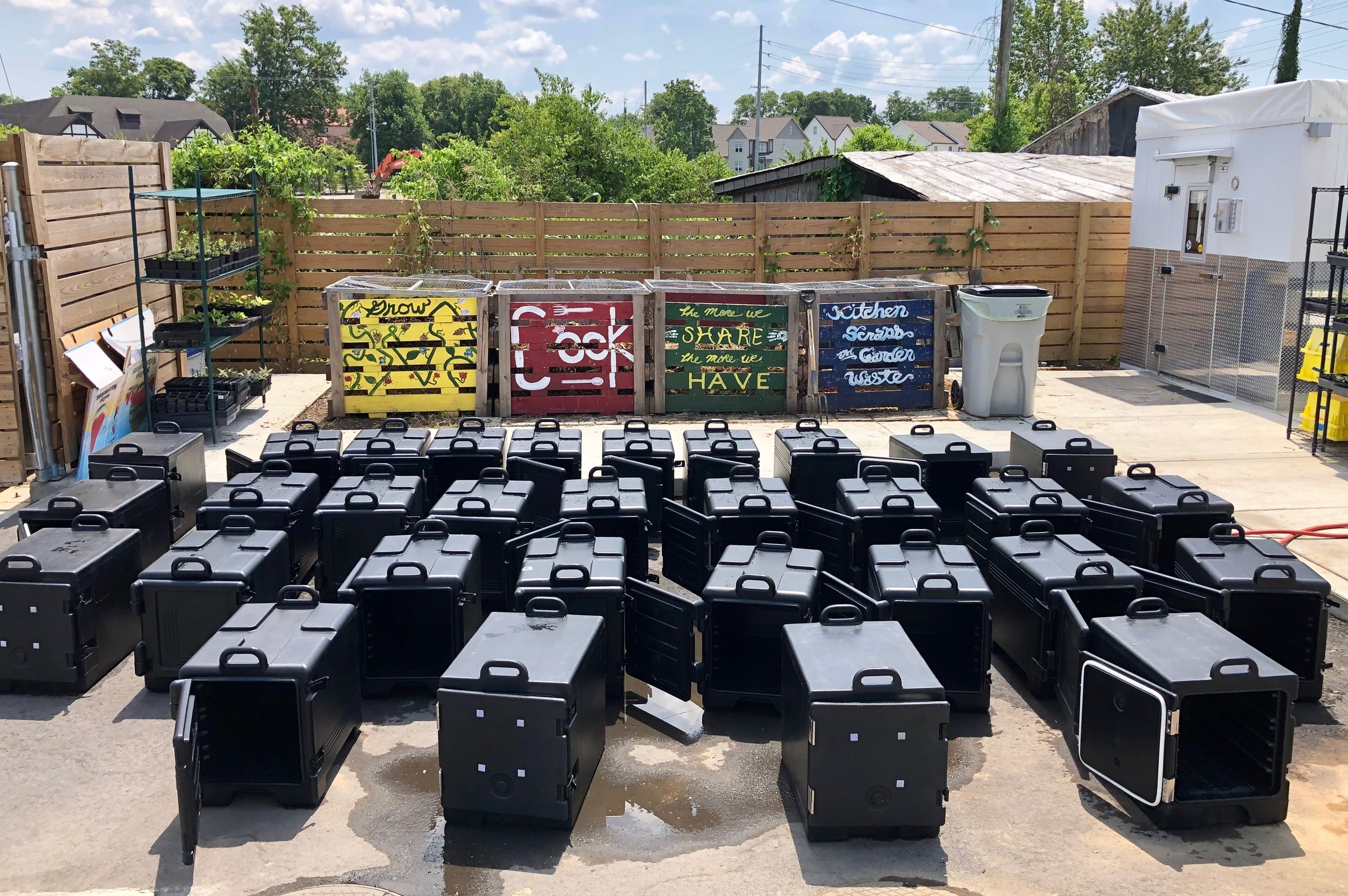 Insulated food carriers used to deliver meals. All of these (plus more!) were cram-packed with freshly made, nutritious meals cooked in our two kitchens by TNFP staff, interns and volunteers.