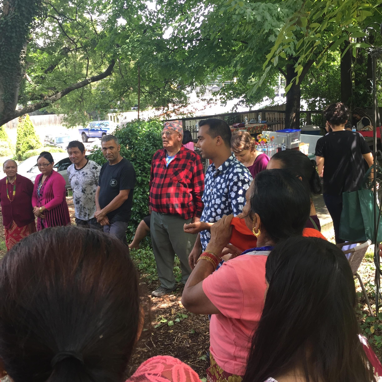 Siddi translating introductions at a community garden potluck.