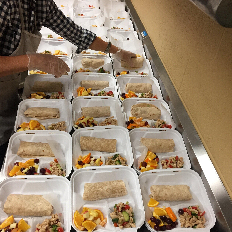 TNFP volunteer plating mobile meals at St. Luke's Community House