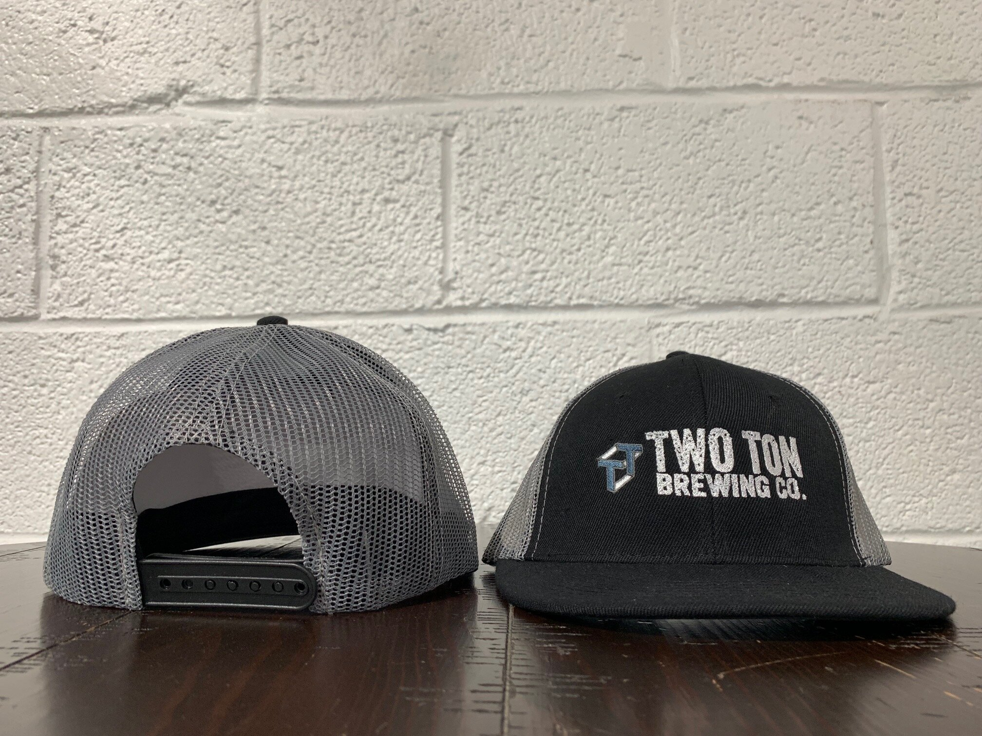 Two Ton Trucker Hat    20.00   Trucker style cap with adjustable back.  One size fits most.