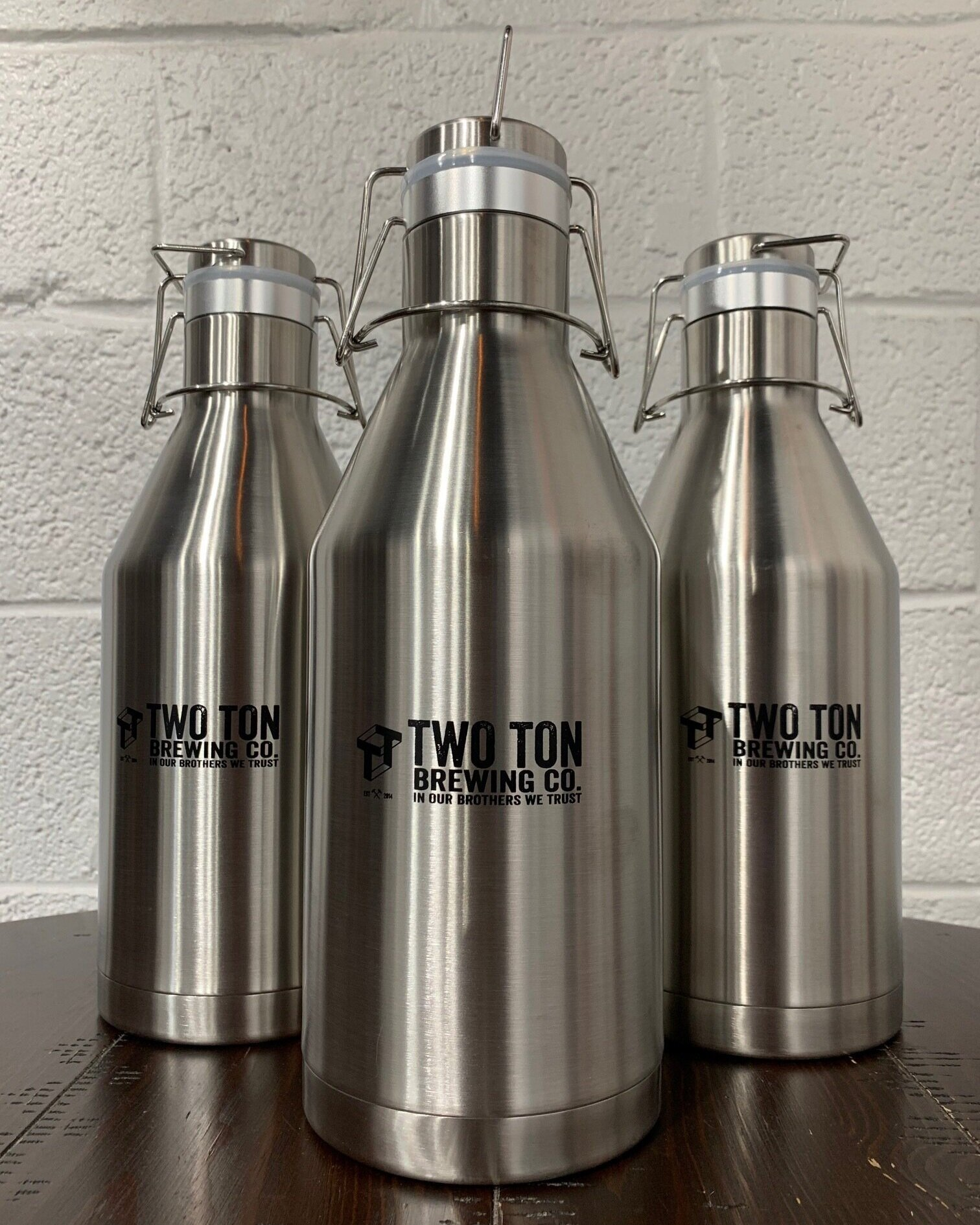 Two Ton Growler (Filled)    $50.00   Double-walled stainless steel branded growler with swing-top lid to keep your beers cold and fresh longer! 64oz capacity. Comes filled with your selection from the menu board when you purchase.