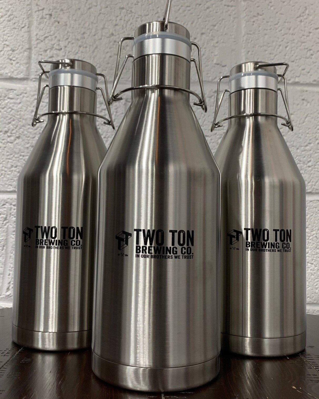 Two Ton Growler (Empty)    $35.00   Double-walled stainless steel growler with swing-top lid keeps your beverages cold and fresh longer! 64oz capacity. Can be purchased empty. But why?!?!