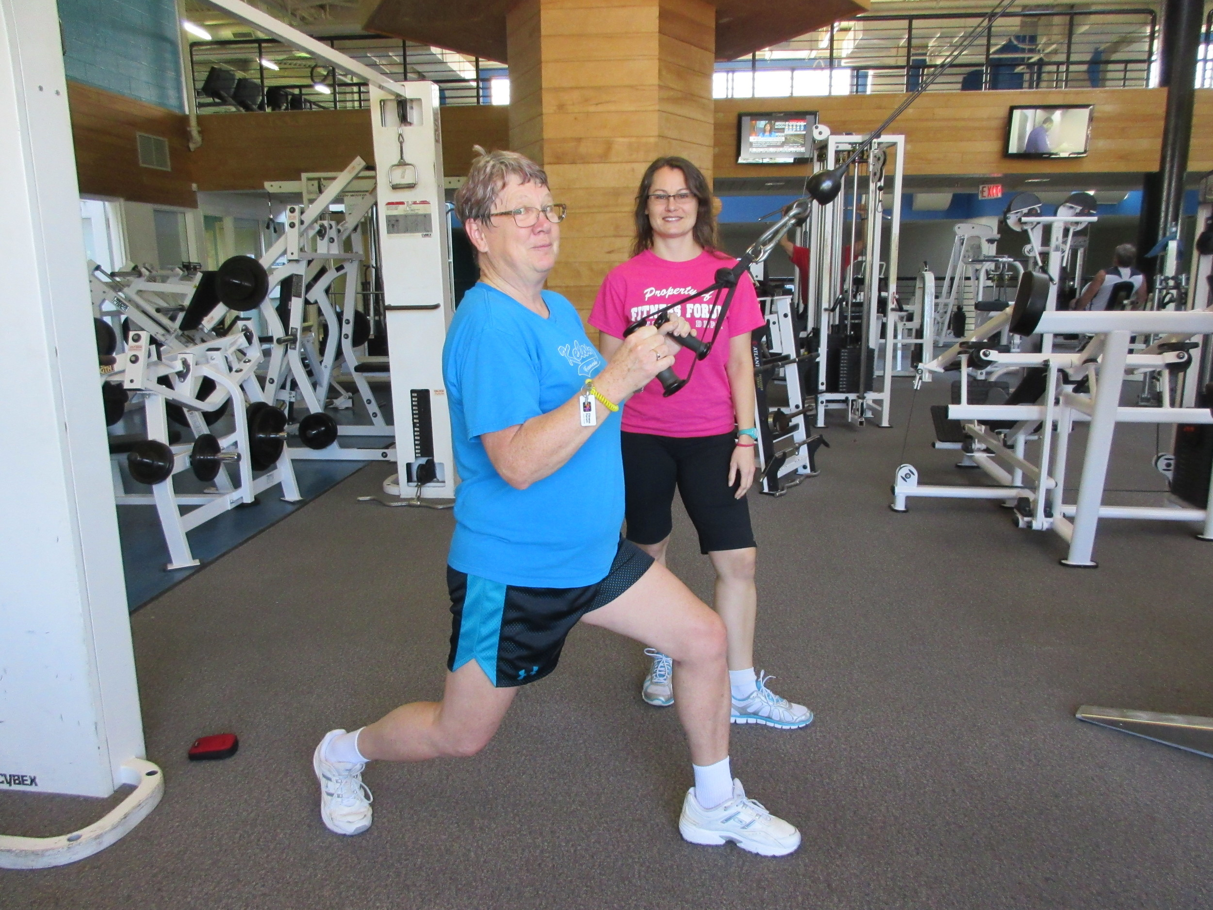 """My trainer and I at Fitness Forum… I decided that I was getting way too stiff and not moving enough. I didn't ever want to have a hip replacement, or a knee replacement or ankle fusion. I'm trying to avoid it."""