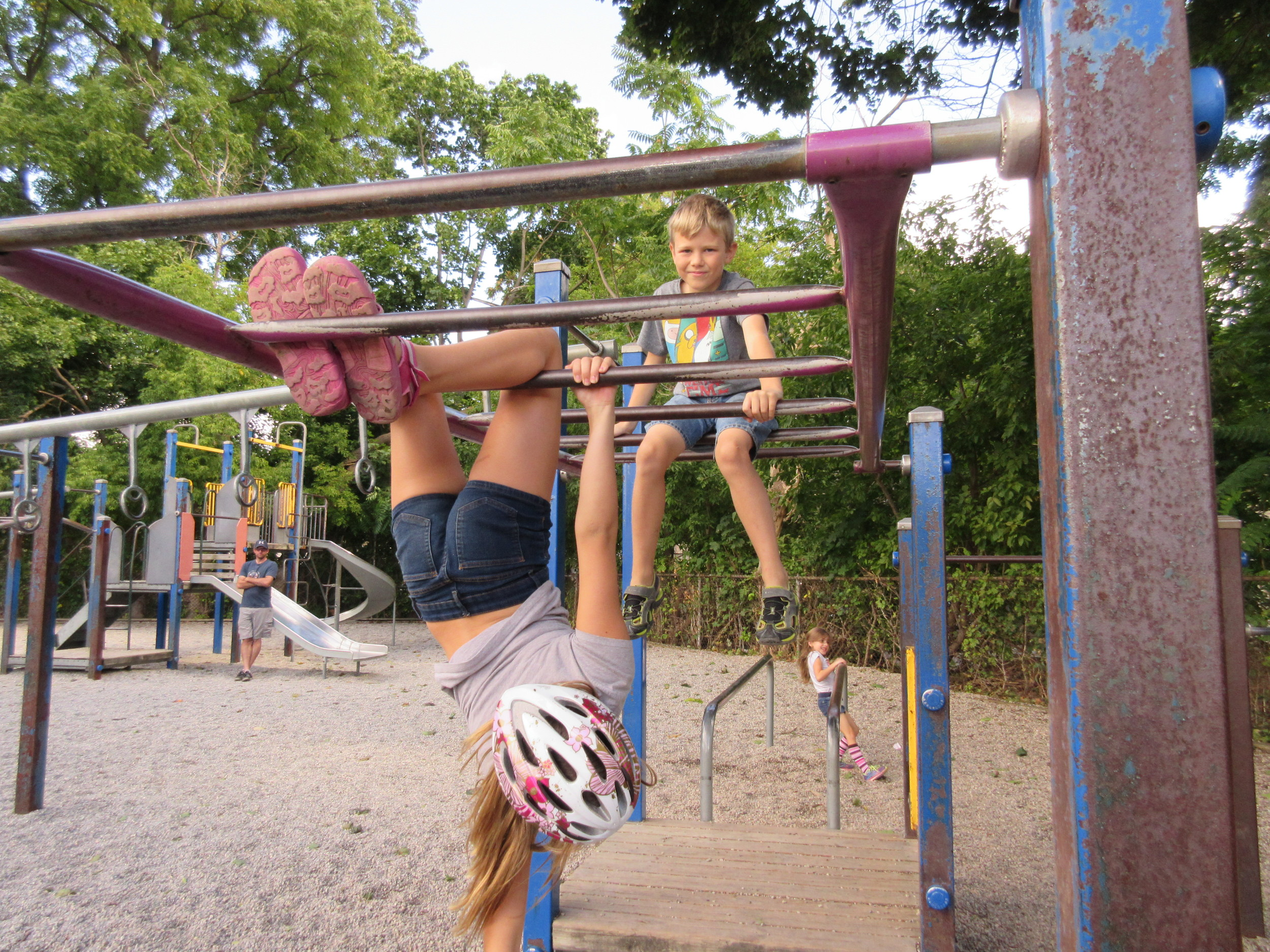 """""""It's fun to hang off the monkey bars. It a good spot to be because you can see all of the trees and grass"""""""