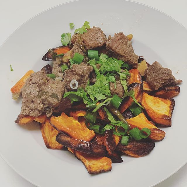 Instant Pot Hunan beef with sweet potatoes . INGREDIENTS: 4 tbsp red wine 2 tbsp salt 2.5 tbsp soy sauce  2 tbsp peanut oil 2 tbsp sesame oil 3 tbsp fresh ginger, diced 4 garlic cloves, diced 3 scallions, chopped 2 handfuls of cilantro, chopped 4 small chilies 2 tbsp cumin (or more, I ran out) 48 oz beef shoulder, cubed . DIRECTIONS: 1. Put everything in a bowl, but first salt the meat with any amount of salt you prefer. Spare one scallion and handful of cilantro for garnish . 2. Refrigerate / marinate while you prep the sweet potatoes - just cube and roast with olive oil and salt at 450 degrees, check periodically for your desired level of crispiness . 3. Put the marinating meat and all the sauce in the instant pot and set for 16 min. 4. Serve the meat over the roasted sweet potatoes and be sure to spoon extra sauce over everything. Add scallions and cilantro for garnish. . If like to try this again with a different cut of meat, or with the same shoulder but slow cooked. It's basically taking a @nytcooking recipe and instapotting it. I think it will be great on day 2, it's one of those... * * * * * #hunanbeef #instantpot #intantpotrecipes #sweetpotatoes #paleo #glutenfree #beef #cilantro #easydinners #timeforbed