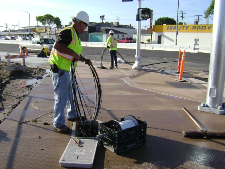 Pulling Traffic Signal Wire into conduits.jpg
