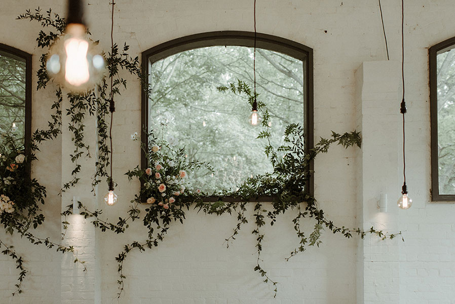 summer unique wedding insallation with vines and garden roses.
