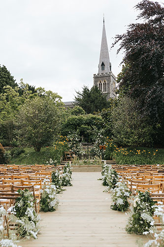 wild unique meadow lined aisle with ammi and garden roses at an elegant summer wedding in London