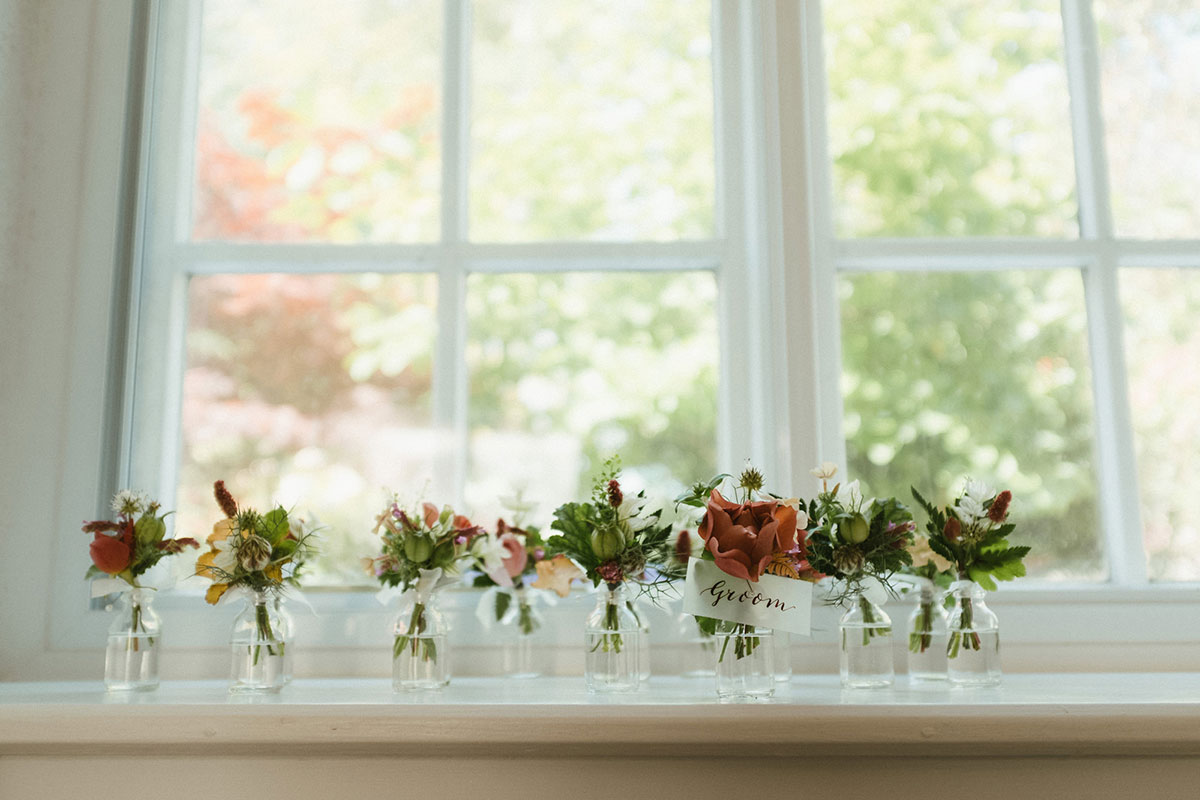 summer wedding buttonholes with garden roses and wild flowers