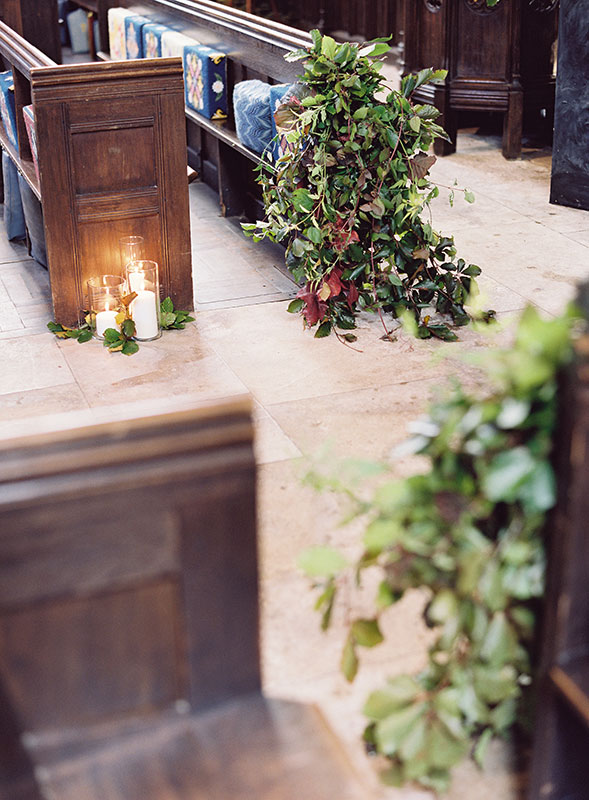 unique foliage pew ends with autumnal leaves and candles