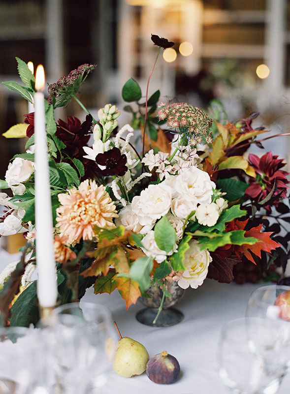 autumnal table centres with wild flowers and garden roses, at St Giles House Dorset