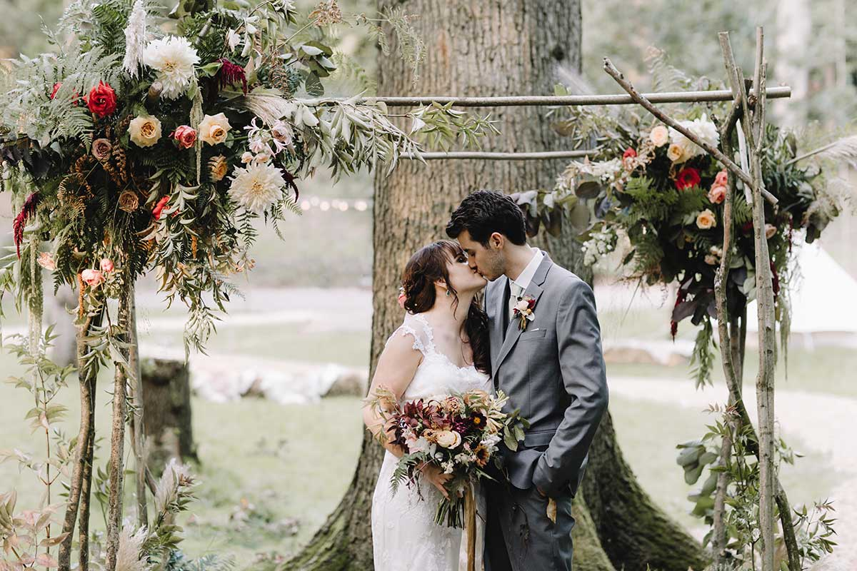 woodland wedding autumnal arch with wild flowers and ferns