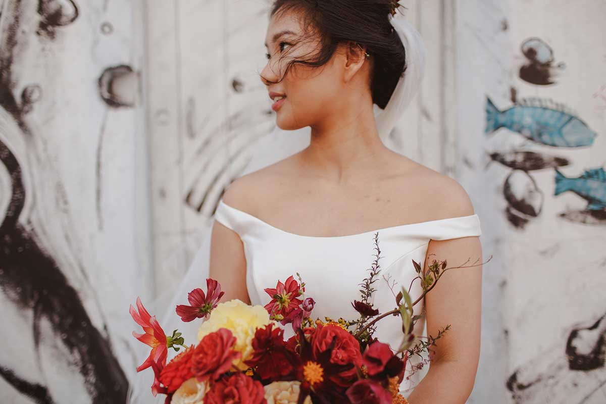 unique bridal bouquet with red flowers and golden garden roses with wild vines for a London wedding