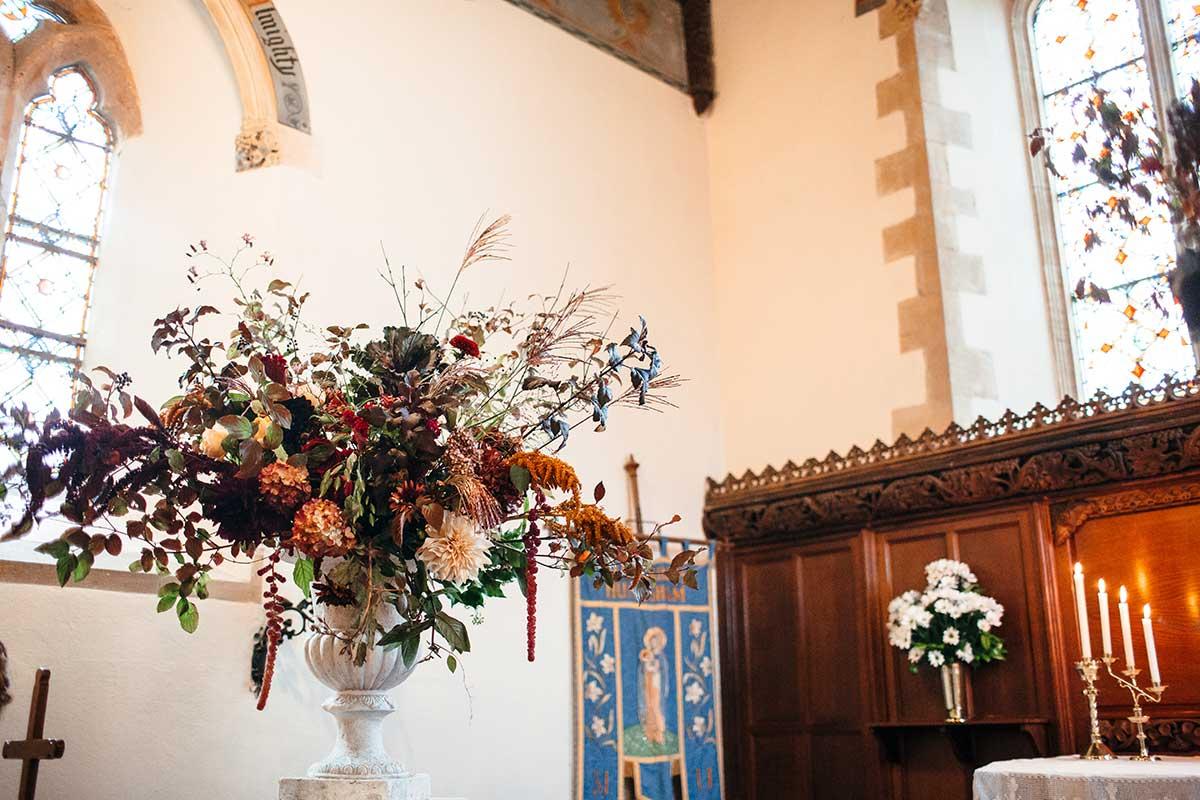 large urn arrangement with autumnal flowers