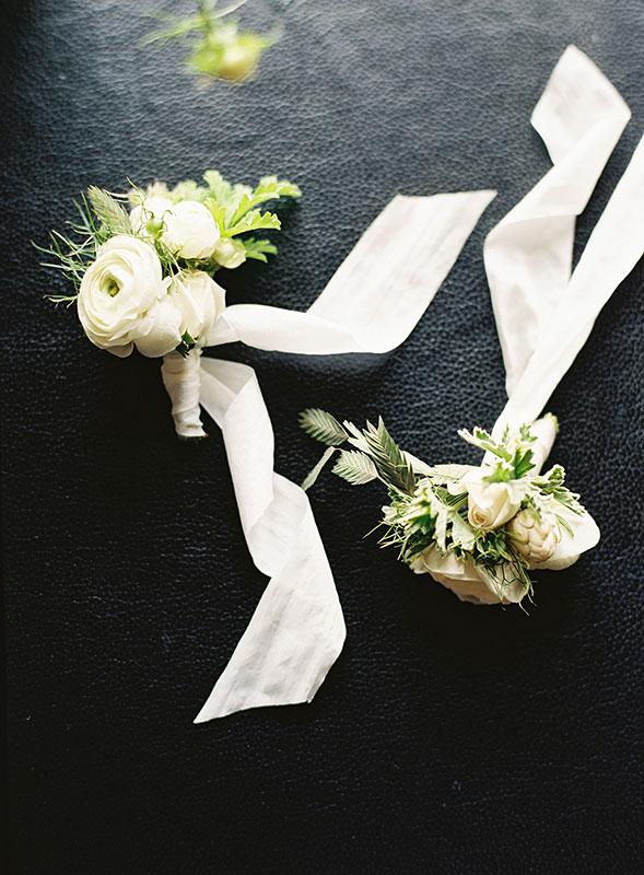 Vervain Unique white wedding florals castle combe Wiltshire corsgaes with silk ribbon