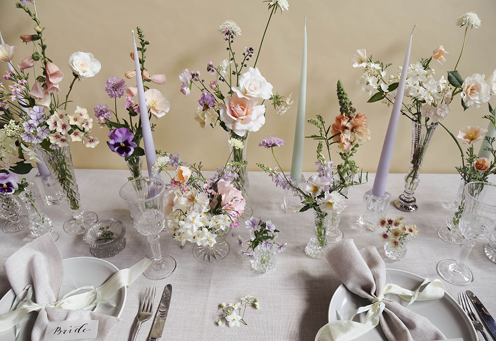 wedding table design cut glass and pastel summer flowers