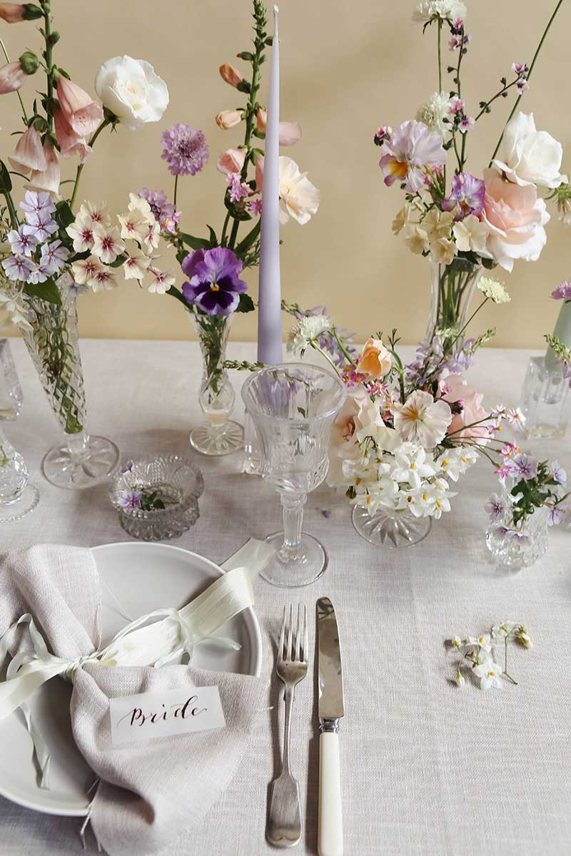 wedding table design cut glass and pastel summer flowers vervain