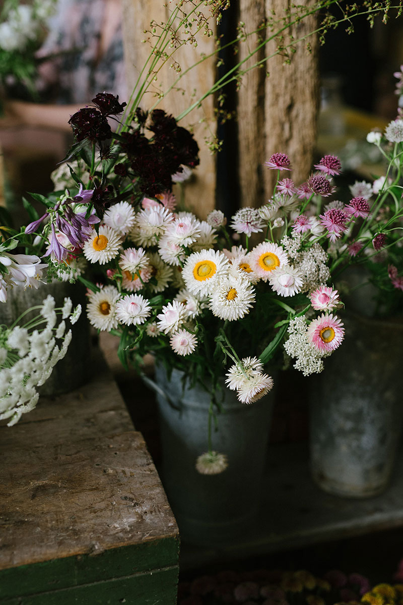 Buckets of farm grown flowers at one of Vervain's Summer classes.