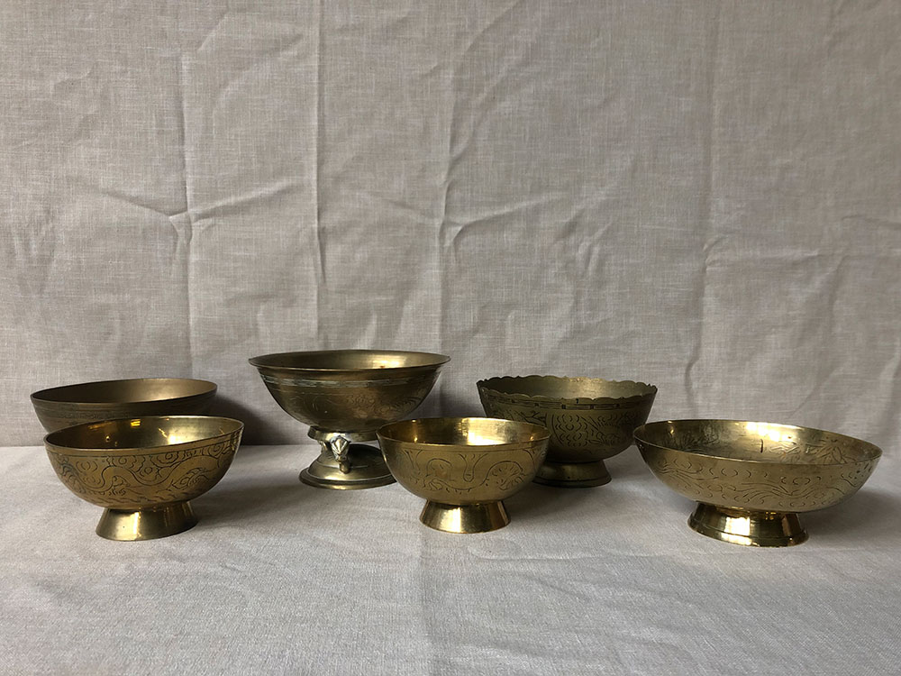 Selection of larger antique brass footed bowls