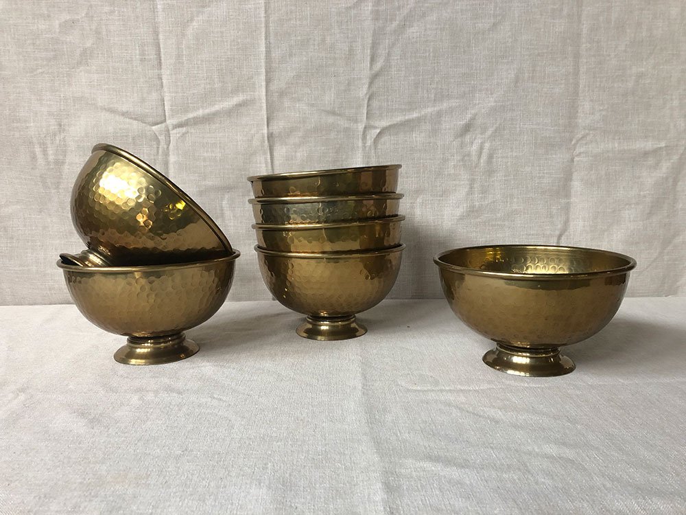 Large hammered metal gold footed bowls