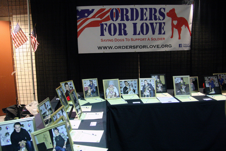 """The Hershey Bears wives organization """"Bears Better Halves"""" held a fundraiser earlier this year to support Orders For Love. Bears players posed with  local shelter  dogs looking for homes and those pictures were then signed and auctioned off to fans. The Bears wives also sold homemade dog treats to raise additional funds."""