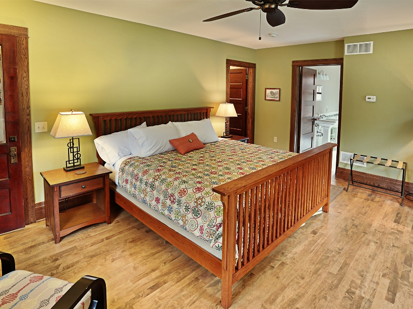 University Suite Bedroom with Soft Green-colored Walls.jpg