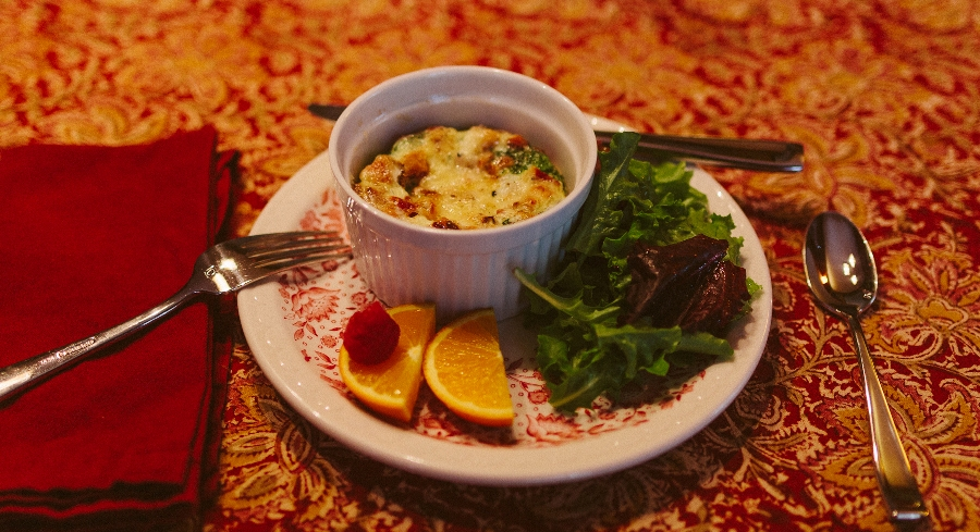Quiche Served with Greens and Fruit Garnish.jpg