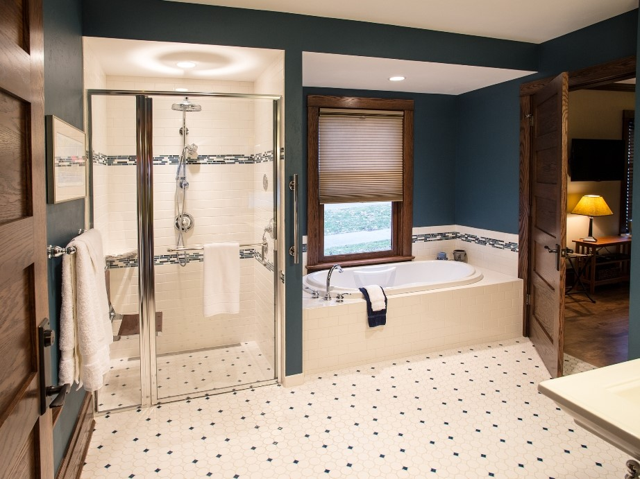 Blue and White Tiled Mendota Suite Bathroom Has Jetted Tub and Roll-in Shower with Drop Down Seat and Multiple Shower Heads.jpg
